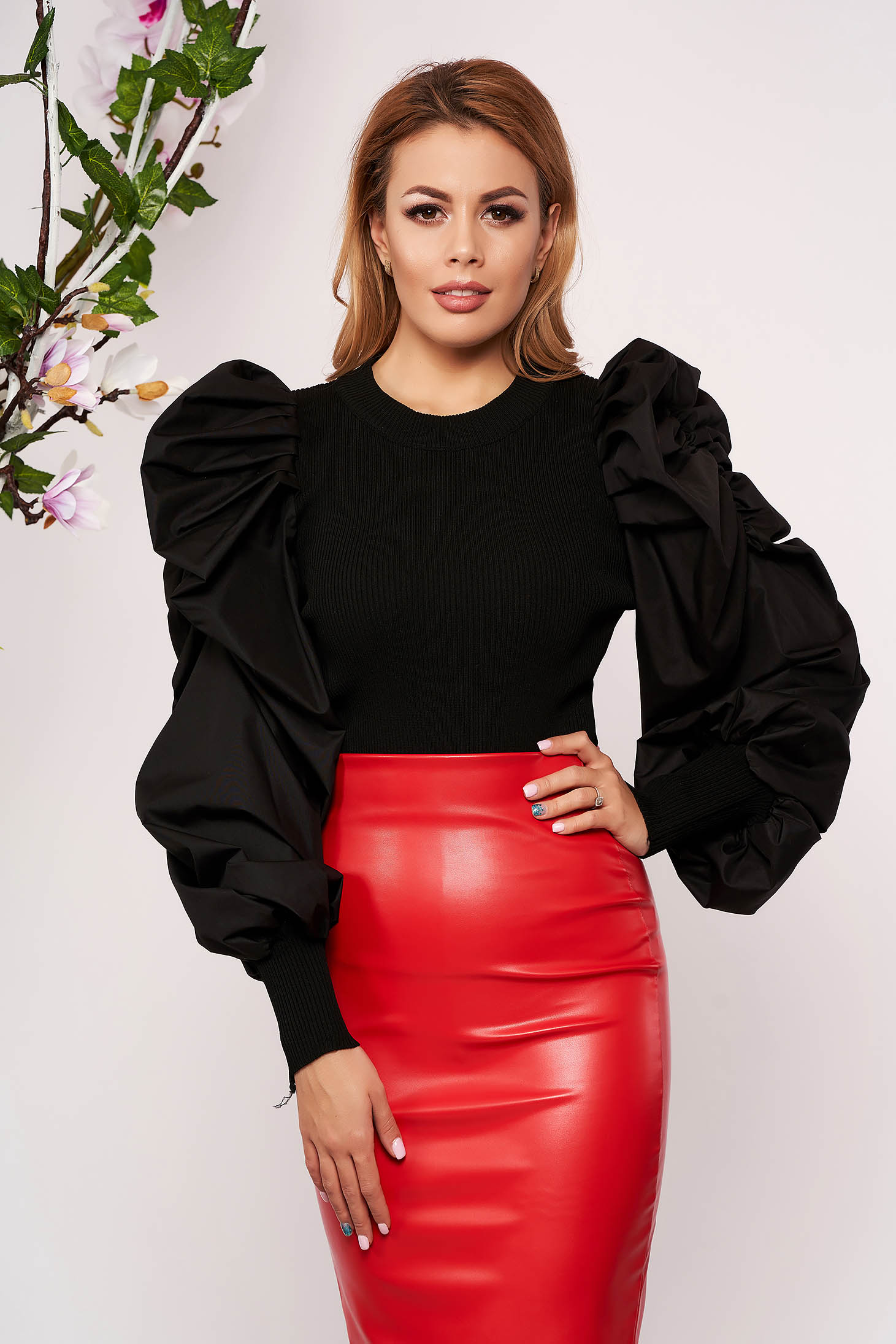 Black women`s blouse elegant arched cut with puffed sleeves long sleeved knitted short cut